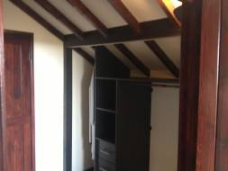 another interior fitted into the eaves of a room providing a function use of the space
